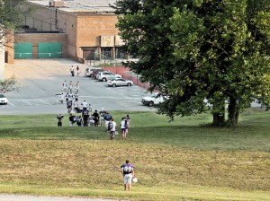 """CHS football players walk down """"the hill"""" after practice / Photo by Roger Starkey"""