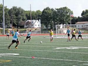 The 2013 Kahoks boys soccer team during a preseason practice / Photo by Roger Starkey