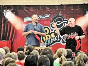 DIS 6th grade teacher Brad Snow shares a laugh with Tim Hannig during the Pro-Kids show / Photo by Roger Starkey