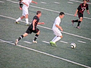 Junior midfielder Grant Bauer in action against Highland on Sept. 4 / Photo by Roger Starkey