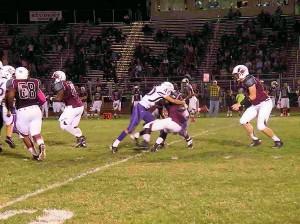 Collinsville junior linebacker Mark Garcia sacks West's Brian Hill / Photo by Roger Starkey