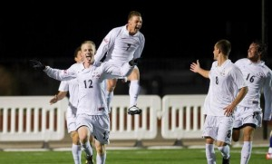 Gabe Christianson (12) celebrates with teammates after scoring the game-winning goal in SIUE's 1-0 victory over Evansville / Photo by SIUE Sports Information