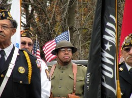 Richard D. Ford prepares to march in the 2013 Collinsville Veterans Day parade. Ford is a military historian who was paying to his great uncle George Ford, who was assigned to the French Army in World War I. George  was in the 372 Infantry, one of four African-American regiments assigned to the French  / Photo by Roger Starkey