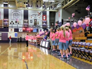 Collinsville Head Coach Lori Billy addresses the crowd before the Pink Out game / Photo by Roger Starkey
