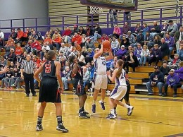 Kassidy Smith goes up for a basket against Edwardsville on Dec. 9 / Photo by Roger Starkey