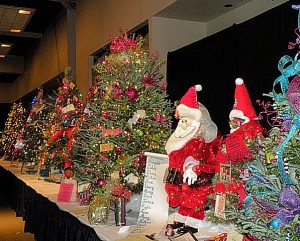A table of trees and decorations at the 2013 Festival of Trees / Photo by Roger Starkey