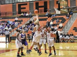 Gabby Morgan rises above Edwardsville defenders to take a shot on Jan. 14, 2014
