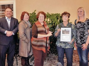 Members of Collinsville Progress present the Carl Schultze Improvement of the Month Award to members of the Collinsville Garden Club / Submitted Photo