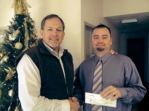 Collinsville Evening Lions Club President Mark Bryant presenting a check to John Griffith, Director of Student Services for Collinsville Unit 10 / Submitted Photo