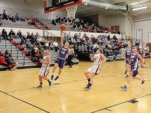 Andrea Frerker drives for a layup / Photo by Roger Starkey