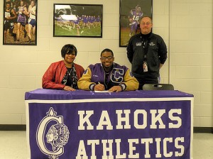 Nate Collier, with his mother, Jarvis Collier and CHS Head Football Coach John Blaylock / Photo by Roger Starkey