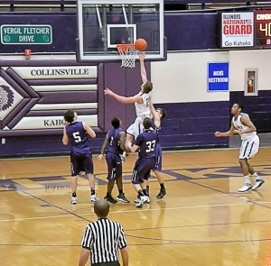 Jacob Shaffer drives the lane against Mascoutah / Photo by Roger Starkey