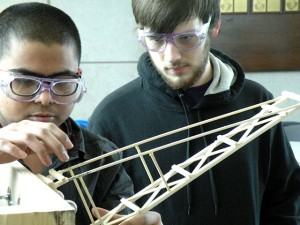 Collinsville High School students Kushan Patel (left) and Logan Hartley compete in the boomilever event at the Regional Science Olympiad on Feb. 15. The CHS Science Club qualified for the State Science Olympiad / Photo by Roger Starkey