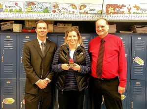 February Unit 10 Teacher of the Month Vicki Hunter. Rick Kincheloe, of Edward Jones, is to Hunter's right and Jefferson Elementary School Principal Dave Stroot is on Hunter's left