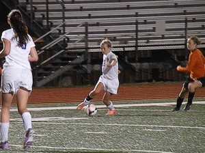 Hanna Liljegren in action against Edawrdsville March 27, 2014 / Photo by Roger Starkey