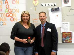 Collinsville Middle School Teacher Jennifer Reeves (left), the March 2014 Edward Jones Unit 10 Teacher of the Month. Rick Kincheloe, of Edward Jones, presented the award / Photo by Roger Starkey