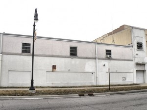701 W. Main St. in the foreground and 703 W. Main St in the background. Both buildings will be demolished when the last tenant in 701 W Main St. relocates / Photo by Roger Starkey