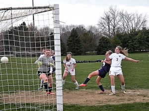 Hanna Liljegren knocks home the first goal in the Kahoks' 5-1 victory over Alton on April 10, 2014 / Photo by Roger Starkey