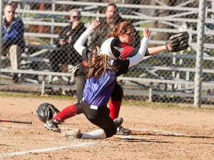 Emily Lautz slides in to home safely / Photo by Sherry Holten