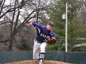 Zach Mathes pitches against Mascoutah on April 4, 2014 / Photo by Roger Starkey