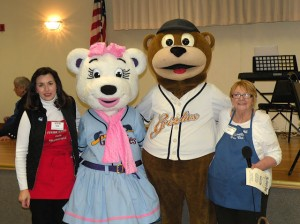 Left to right: Barb Kusmierczak of the Collinsville Junior Service Club, Lizzie the Grizzly, Izzy the Grizzly and Barb Smock of the Collinsville Women's Club at that 2014 Empty Bowl fundraiser / Photo by Roger Starkey