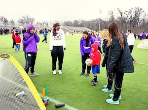 Lady Kahok girls soccer players volunteering at SPENSA / Submitted photo