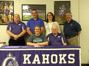 Courtney Otradovec signs with Iowa Central Community College. Alongside Otradovec is Collinsville Middle School Bowling Coach Joe Legendre. Standing, left to right: Sean Hay (CHS Bowling Coach), Brian (father), Pam (mother) and Gregg Haden (Iowa Central Bowling Coach) / Photo by Roger Starkey