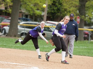Audrey Allard throws the ball to first base while Samantha Buettner looks on / Photo by Sherry Holten