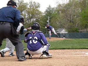 Kyle Reeves pitches to Dylan McEwen while an O'Fallon player prepares to bunt / Photo by Roger Starkey