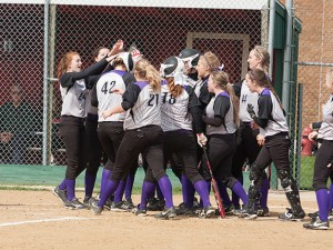 Kassidy Smith is greeted at home plate by her teammates after setting the CHS single-season home run record / Photo by Sherry Holten