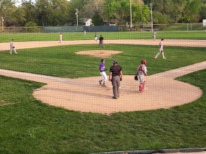 Kyle Reeves scores the winning run against Alton on May 6, 2014 / Photo by Roger Starkey