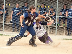 Samantha Buettner slides home safely / Photo by Sherry Holten