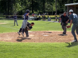 Grant Bauer tagged out at the plate / Photo by John Layton