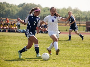 Gabby Suria (#6) defends against Belleville East / Photo by Sherry Holten