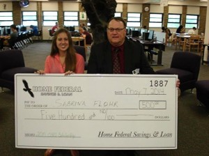 Sabrina Flohr, scholarship winner, with Ron Shambaugh, president and CEO of Home Federal Savings & Loan / submitted photo