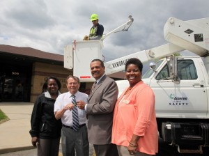 From left, Gussie Reed, Division V Director for Ameren Illinois, Caseyville Mayor Leonard Black, Ameren Illinois President and CEO Richard Mark, and Paula Nixon, Community Relations Coordinator for Ameren Illinois. In the bucket, is Ameren Illinois Lineman Mike Sapienza. Mark was presenting the keys to Mayor Black / Photo by Brian Bretsch