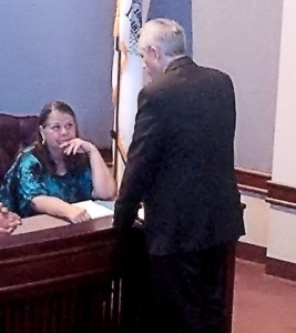Dollie, who lost two daughters to heroin addiction, and nearly lost a third, speaks with Madison County State's Attorney Tom Gibbons prior to a Madison County Heroin Task Force meeting Friday, June 13 / Photo by Roger Starkey