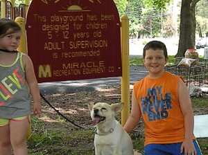 Logan O'Donnell poses proudly with Sadie while younger sister Lilli peeks in to the picture / Photo by Roger Starkey