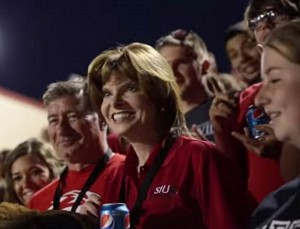 SIUE Chancellor Julie Furst-Bowe on the precipice of participating in the world record for most soda cans opened simultaneously (1.134) / Image from an SIUE video