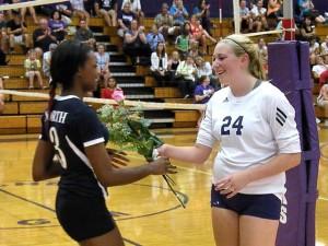 Gabby Hancher giving rose to Brandi Stevenson