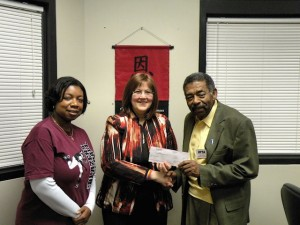 Lorraine Linder, middle, receives a grant check from Illinois Retired Teachers Association board member Ed Gray. Collinsville Middle School Principal Kim Jackson, left, looks on / Photo by Roger Starkey