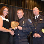 Brad Akers, is presented the 2014 Collinsville Police Officer of the Year Award / Submitted photo