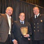 Chris Frawley proudly displays his 2014 Collinsville Firefighter of the Year Award / Submitted photo
