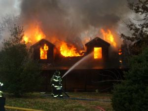 Firefighters battle a blaze that destroyed a home in the 6900 block of Loyet, Collinsville, Dec. 16 / Photo courtesy of Lannie Altenberger