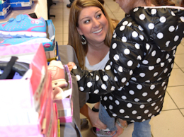 Collinsville Charities for Children's volunteer gives shoes and socks to a needy child on Dec. 10, 2014 at Jack Schmitt Ford / Submitted photo