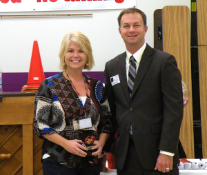 Jennifer Keene, Collinsville Unit 10 December Teacher of the Month, with Rick Kincheloe of Edward Jones, the award's sponsor / Photo by Roger Starkey